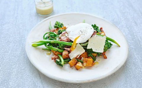 Poached egg salad with bacon, tender stem broccoli and butternut squash
